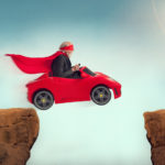 active senior superhero driving a car off a ravine